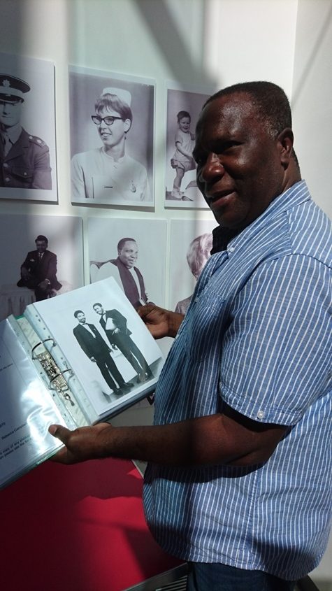 Photo of Linval Angel showing Redding Collection photo of his brother Wilbert